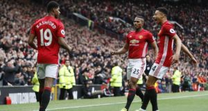 "Britain Soccer Football - Manchester United v Chelsea - Premier League - Old Trafford - 16/4/17 Manchester United's Marcus Rashford celebrates scoring their first goal with Antonio Valencia and Jesse Lingard  Action Images via Reuters / Carl Recine Livepic EDITORIAL USE ONLY. No use with unauthorized audio, video, data, fixture lists, club/league logos or ""live"" services. Online in-match use limited to 45 images, no video emulation. No use in betting, games or single club/league/player publications.  Please contact your account representative for further details."