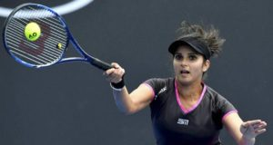 MELBOURNE: India's Sania Mirza, plays a forehand shot as she and partner Barbora Strycova play Australia's Samantha Stosur and China's Zhang Shuai in a second round women's doubles match at the Australian Open tennis championships in Melbourne, Australia, Friday, Jan. 20, 2017. AP/PTI(AP1_20_2017_000009A)