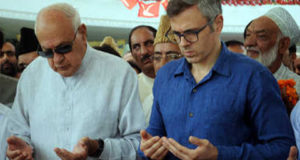 September-8,2015-SRINAGAR: Former Union Minister for New and Renewable Energy , and  J&K National Conference party president  Dr. Farooq Abdullah  along with his son and  Former Chief Minister Omar Abdullah  offering Fateha (prayers)  for  National Conference founder Sheikh Mohammad Abdullah on his 33st death anniversary at his grave in Hazratbal Srinagar on  Tuesday .  Photo: Amin War
