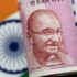 FILE PHOTO: An India Rupee note is seen in this illustration photo June 1, 2017. REUTERS/Thomas White/Illustration/File Photo